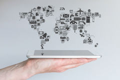 Global mobile devices and internet of things concept. Hand holding modern tablet or smart phone Stock Photography