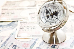 Global model clock on Japanese notes Royalty Free Stock Image