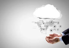 Global net. Close up of businessman hand holding cloud with social net concept Royalty Free Stock Photography
