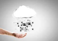 Global net. Close up of businessman hand holding cloud with social net concept Stock Image