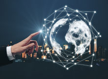 Global network, business and communication concept. Businessman pointing at abstract digital globe on illuminated night city background. Global network. business royalty free stock images