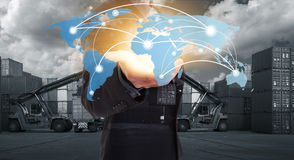 Global network coverage world map on hand of businessman. Global network coverage world map on hand of businessman, Industrial Container Cargo yard for Stock Photography
