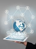 Global network and Tablet. On hand Royalty Free Stock Images