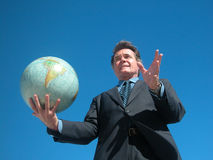 Global Opportunity. Businessman holding a globe Royalty Free Stock Photography