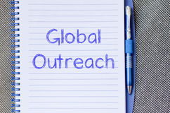Global outreach write on notebook Stock Photos