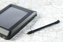 Global positioning system device. GPS global positioning device arranged with stylus pen and map Royalty Free Stock Images