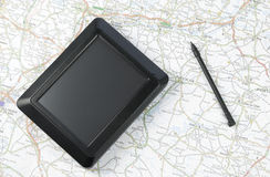 Global positioning system device. GPS global positioning device arranged with stylus pen and map Stock Photos