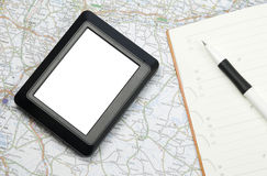 Global positioning system device. GPS global positioning device with white screen arranged with map, notebook and pencil Royalty Free Stock Photography