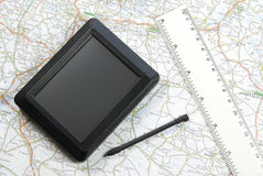 Global positioning system device. GPS global positioning device with stylus pen and ruler arranged with map Stock Photo