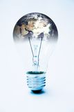 Global power. Light bulb & planet earth (courtesy of NASA) global power concept - image is supposed to be quite stark & contrasty royalty free stock photos