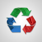 Global recycling icon with embossed elements and colors Royalty Free Stock Photography