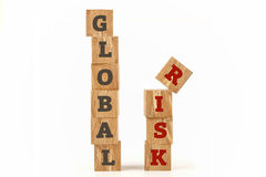 Global Risk word written on cube shape. Global Risk word written on cube shape wooden surface isolated on white background Royalty Free Stock Photo