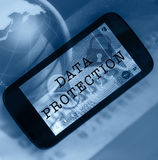 GLobal security. Concept. Smartphone and data protection wording. Glass globe in the background Royalty Free Stock Photo