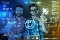 Professional programmers using new security application. Global security. Professional team of programmers touching futuristic screen while using a new Stock Image