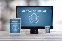 Global sourcing concept on different devices. Global sourcing concept shown on different information technology devices Royalty Free Stock Photo