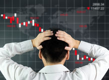 Global stock market declining. An investor is looking at screen showing stock market crash Stock Image