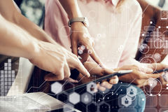 Global Strategy Virtual Icon Innovation Graph Interfaces.Young Coworkers Team Analyze Meeting Report Electronic Gadgets Royalty Free Stock Images