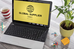 Global supplier concept on a laptop. Laptop on a desk with global supplier concept on the screen Royalty Free Stock Image