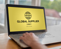Global supplier concept on a laptop. Man using a laptop with global supplier concept on the screen Royalty Free Stock Photography