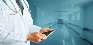 Global Technology In Medicine And Healthcare ConceptUnrecognizable Doctor Using Digital Tablet In Clinic stock photos