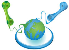 Global Telecommunication. Illustration of two colored (green and blue) phone receivers with cord, connecting to the Earth Stock Photo