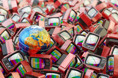 Global television, telecommunication equipment, mass media broadcasting and surveillance concept. Earth globe on heap of red retro tv set receivers with no Royalty Free Stock Image