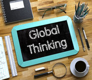 Global Thinking on Small Chalkboard. 3D. Royalty Free Stock Image