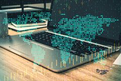 Global trade and information concept. Close up of laptop with digital map and forex chart on office desktop. Blurry background. Global trade and information stock illustration