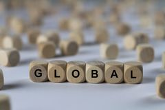 Global - Würfel mit Buchstaben, Zeichen mit hölzernen Würfeln Stockfoto