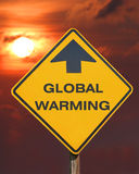 Global Warming. This is a highway sign pointing towards global warming royalty free stock image