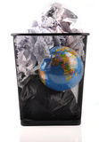 Global warming. Concept - globe on trash bin with waste papers stock image