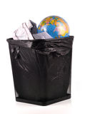 Global warming. Concept - globe on trash bin with waste papers stock images