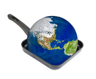 Global Warming. Concept. Earth at the frying pan isolated on white Royalty Free Stock Photos