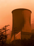 Global warming. Electricity power plant in a foggy morning (orange toned Stock Photography