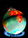 Global Warming. Photo of the earth over a flames to suggest the effect of burning fossil fuels,ie GAS vector illustration