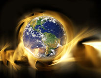 Global warming. With the earth on flaming background Royalty Free Stock Photography