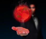 Global warming. Global warming at the hands of businessmen Stock Photos