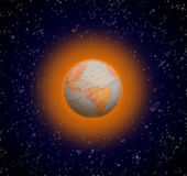 Global warming. Planet earth surrounded by an orange layer that is due to global warming stock photos