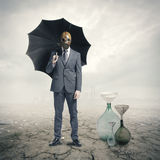 Global Warming. Businessman waiting for the rain royalty free stock image