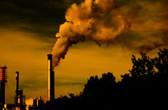 Global Warming. Factory smoke at sunset with shadow copy-space stock photos