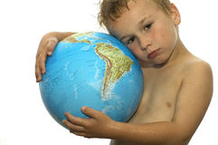 Global Warming. Stop the global warming! Picture of a sweating boy holding a globe, representing the rising temperature on our earth. He's got his whole life in royalty free stock photos