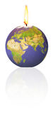 Global warming. Metaphor for global warming : earth burning like candle royalty free stock images