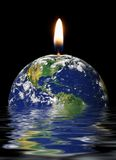 Global warming. Concept with globe burning up in water royalty free stock image