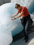 Global warming?. The young man which at edge of a thawing glacier royalty free stock images