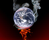 Global warming. The earth smoking on fire. Global warming concept Stock Images