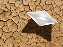 Global warming. Paper boat on dry ground Royalty Free Stock Image