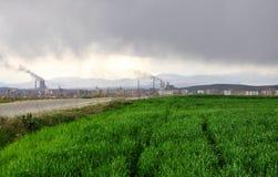 Global warming. Chimneys pollute the fresh air Royalty Free Stock Photo