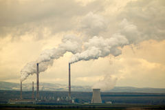 Global warming co2. Global warming emissions, co2 emitted by an energy plant Royalty Free Stock Photography