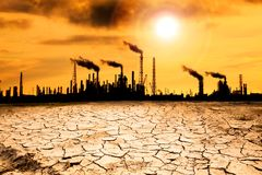 Global warming concept. Refinery with smoke and global warming concept Royalty Free Stock Photo