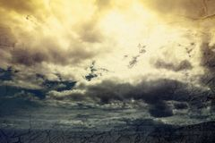 Global warming concept landscape. Dramatic cloudy sky and dry ea. Global warming concept landscape. Dramatic cloudy sky and dry cracked earth Royalty Free Stock Photo